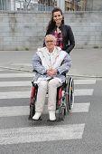 Young woman accompanying elderly woman