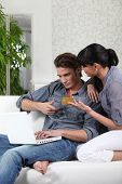Couple making online purchases