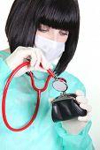 Nurse examining a wallet
