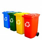 stock photo of segregation  - Red Yellow Green Blue Recycle Bins Isolated - JPG
