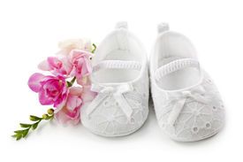 picture of newborn baby girl  - Baby girl shoes with pink flowers isolated on white background - JPG