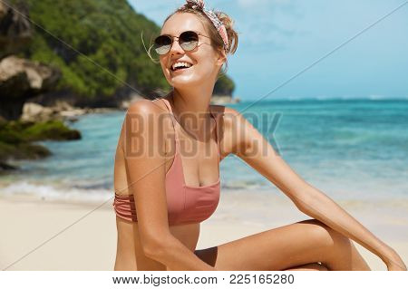 Young Happy Female Wears Sunglasses