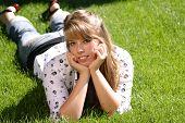 Teenage Girl Laying In The Grass