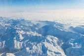 Aerial View Of The Swiss Alps. Flying Over Alps. Mazing View On Mountain. poster