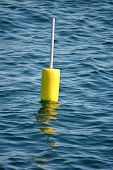 Bright Yellow Bouy in the Ocean