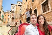 Romantic travel couple in Venice on Gondola ride romance in boat talking happy together on travel va poster