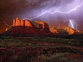 An Hdr Composition Of A Lightning Storm Approaching Courthouse Butte Near Sedona Arizona. Composed F poster