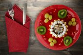 Dessert Of Cake And Fruit (grapes, Kiwi, Pomegranate) On A Wooden Background. Dessert On A Plate Top poster