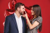 Affectionate Couple With Red Balloons. Valentines Day poster