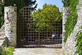 Typical Tuscan Steel Gate With Intercom And Alarm System. Automatic Gate In Front Of The Driveway In poster