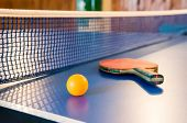 Table Tennis - Racket, Ball, Table. Tabletennis Or Ping Pong Rackets And Yellow Balls On Blue Table. poster