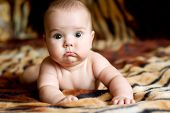stock photo of cute baby  - Cute baby very low DOF natural light from window iso 200 focus in on child - JPG