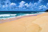 Waves Crashing Onto A Rural Sandy Beach Taken At Keawaula Beach In Oahu, Hi Where People Can Go Swim poster