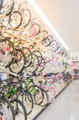 Blurred Three Tier Sloping Display Rack Bicycles At Sporting Goods Chain In America poster