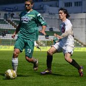 KAPOSVAR, HUNGARY - JULY 30: Walter Fernandez (in white 29) in action at a Hungarian National Championship soccer game - Kaposvar (green) vs Videoton (white) on July 30, 2011 in Kaposvar, Hungary.
