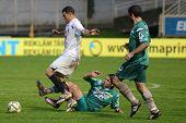 KAPOSVAR, HUNGARY - JULY 30: Andre Alves (in white) in action at a Hungarian National Championship soccer game - Kaposvar (green) vs Videoton (white) on July 30, 2011 in Kaposvar, Hungary.