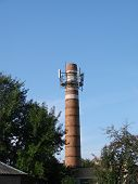 The Old Water Tower Is Used As A Cell Tower. The Concept Of Converting One Into Another, The Use Of  poster