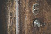 Close Up Of Old Vintage Copper Rusty Keyhold Safe Lock On Metal Door Safe. Old Door Metal Keyhold Wi poster
