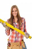 Young smiling woman holding spirit level