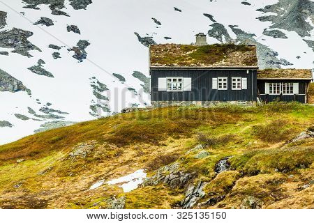 poster of Norwegian Old Country Houses Hytte In The Mountains. Beautiful Winter Landscape In Norway, Scandinav