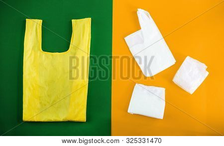 poster of Choice Between Plastic Bag And Eco.bag Canvas For Mockup Blank Template On Yellow And Green Backgrou