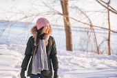 Winter woman walking out on forest walk in cold outdoor nature river outside. Happy asian girl model poster