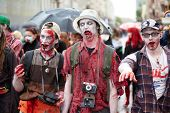 MOSCOW - MAY 14: Three unidentified participants vampires at Zombie Walk on Old Arbat, May 14, 2011,