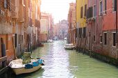 Beautiful Venice Canal In Early Morning Light. Old Narrow Canal With Parked Boats, Venice, Italy. Pi poster
