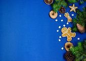 Bright Christmas Or New Year Blue Background With Branches Of Spruce, Christmas Gingerbread Cookies, poster