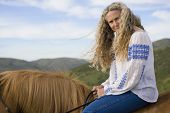 picture of bareback  - Senior woman horse riding bareback - JPG