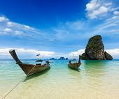 Long tail boats on tropical idyllic beach (Pranang beach), Krabi, Thailand