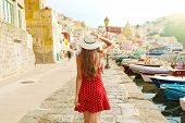 Holidays In Italy. Back View Of Beautiful Girl In Stunning Colorful Harbor Of Procida In Italy. poster