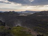 Lava Field Landscape In Landmannalaugar With And Geothermal Fumarole, River Delta And Rhyolit Mounta poster
