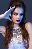 Attractive Young Model With Professional Make Up, Silver Necklace, Volume Hairdo. poster