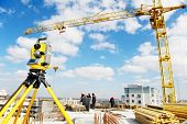 image of theodolite  - Surveying measuring equipment theodolite transit on tripod at construction building area site - JPG