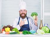 Man Cook Hat And Apron Hold Broccoli. Healthy Nutrition Concept. Bearded Professional Chef Cooking H poster