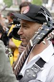 NEW YORK - MAY 1: Rage Against The Machine guitarist Tom Morello among the crowd of the Occupy Guitarmy group during May Day protests in Bryant Park on May 1, 2012 in New York, NY.