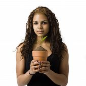Girl Holds Potted Plat