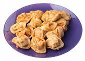 Dumplings On A Purple Plate Isolated On White Background. Dumplings In Tomato Sauce. Dumplings Top S poster