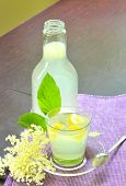 picture of elderflower  - elderflower juice  in glass and cup - JPG