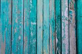 Old Fence With Vertical Boards Of Turquoise Color. Old Paint On The Fence Discolored In Places. Old  poster