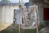 Shooting Range Target After Shooting With Shotgun Bullet Gauge Pellets poster