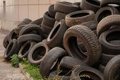 Damaged Tires After High Speed Driving. Pile Of Used Old Damaged Tires. Pile Of Old Car Tires For Ru poster