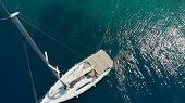Sailing Regatta, Boat Trip, Top View. White Yacht In The Blue Sea, Drone Photo. The Guy Sails Around poster