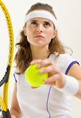 Portrait Of Confident Tennis Player Ready To Serve