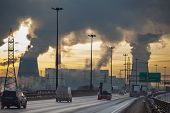 stock photo of cold-weather  - City ringway with cars and air pollution from heat electric generation plant - JPG