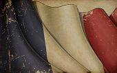 stock photo of french curves  - Illustration of a rusty French flag printed on old paper - JPG