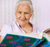 Elderly Woman With Family Album