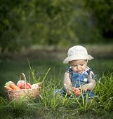 baby with basket of fruits and vegetables