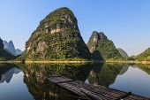 Limestone Hills And Raft At The Li River